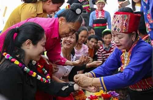 Thread tying ritual - a traditional custom of the Thai