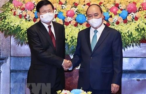 Top Lao leaders Vietnam visit - historical milestone in bilateral ties